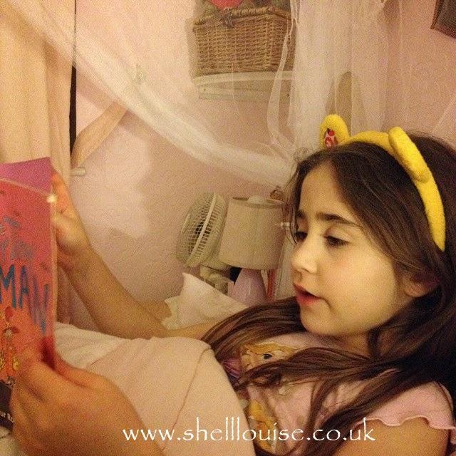 Ella reading at bedtime