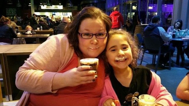 Harry Potter Studio Tour -Kellyann and Ella trying butterbeer