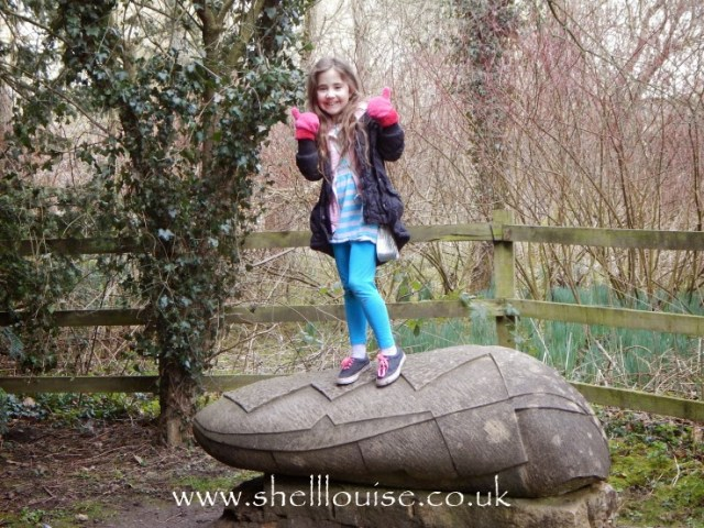 Ella standing on a Sculpture at Rufford Abbey