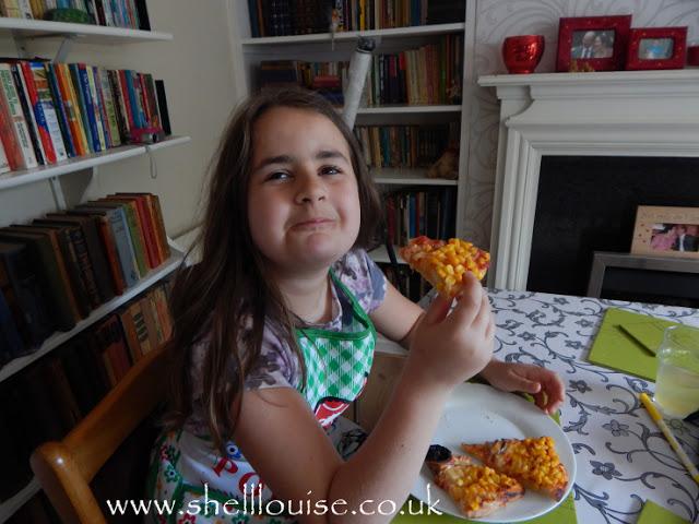 Kaycee enjoying her minion pizza