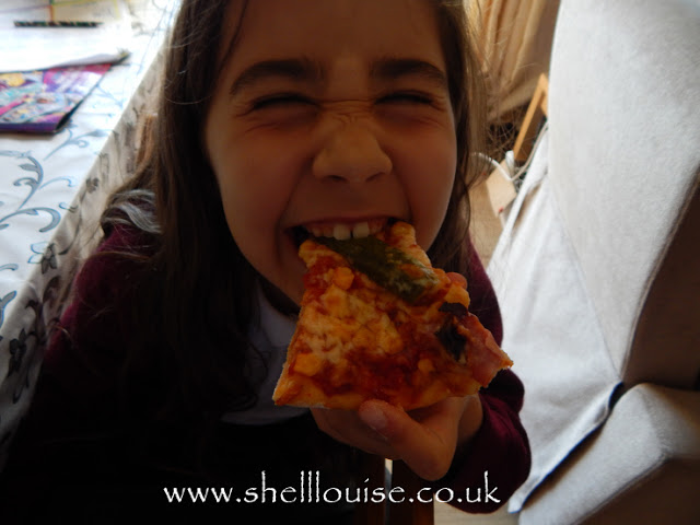 Ella enjoying her pizza