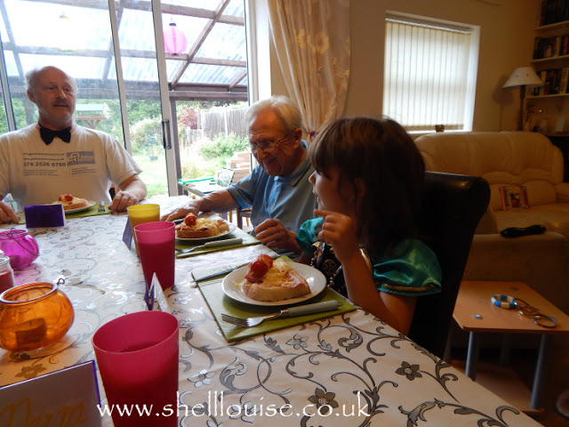 Ant, Granddad and Ella at the dinner table