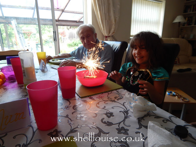 Ella loving her chocolate brownie with sparkler
