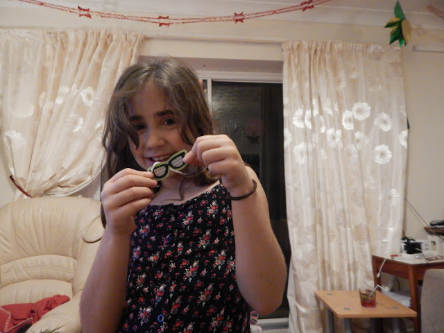 Ella and her glasses necklace
