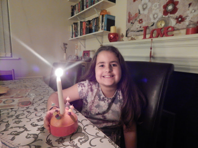 KayCee's Christingle candle lit