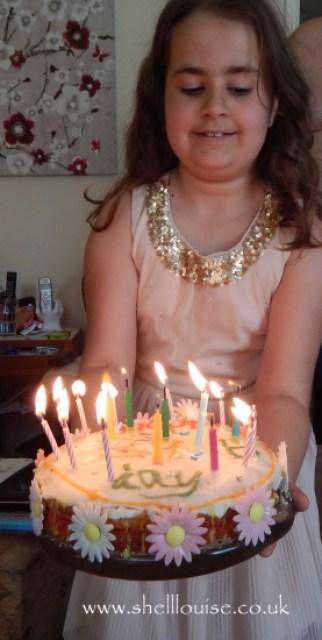 Kaycee bringing in my birthday cake