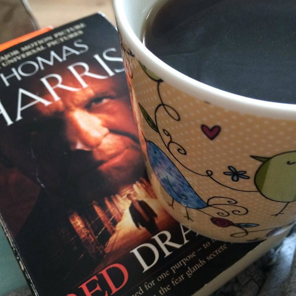 A mug of black coffee and The Red Dragon book by Thomas Harris