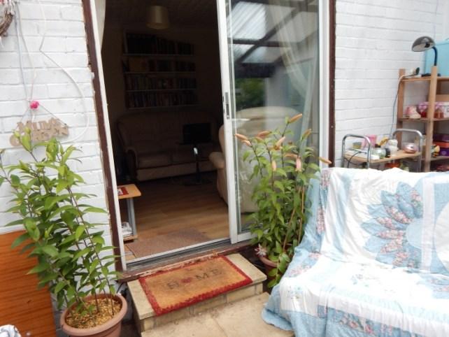 Lilies by the patio door - garden tidy