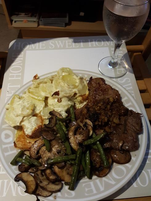 anniversary dinner. potato dauphinoise, baked garlic mushrooms and green beans with steak