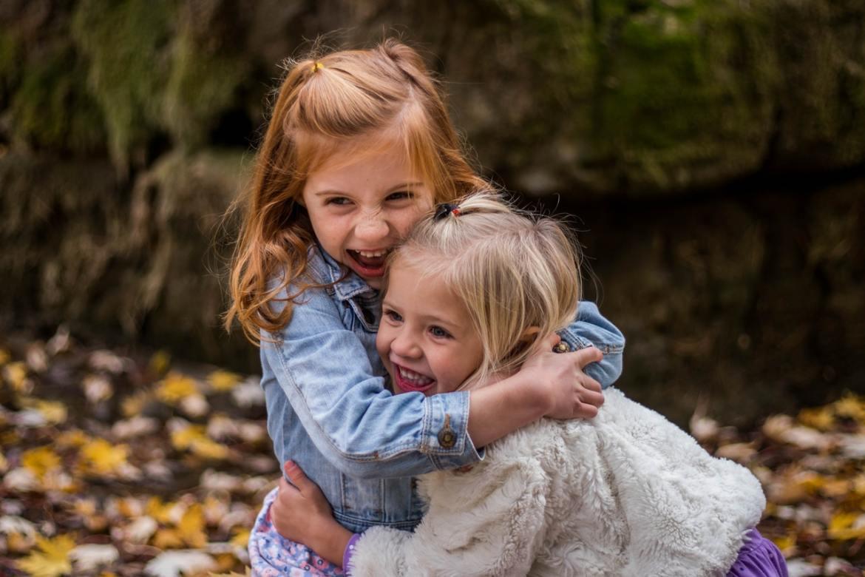2 girls hugging - gardening with children