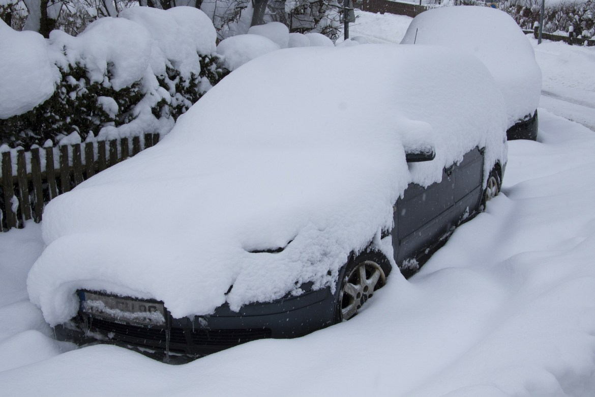 Car covered in snow - Denver winter