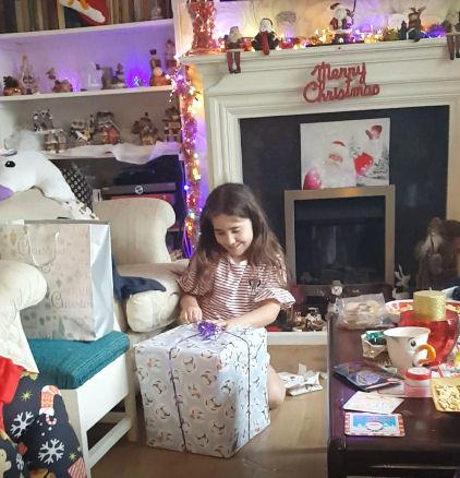 Ella opening her present from Kellyann