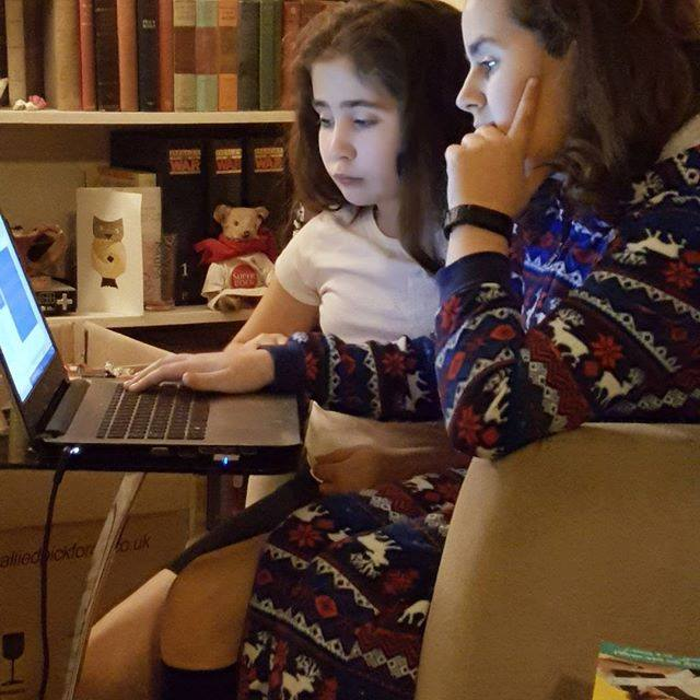 sisterly love - Kaycee helping Ella with homework