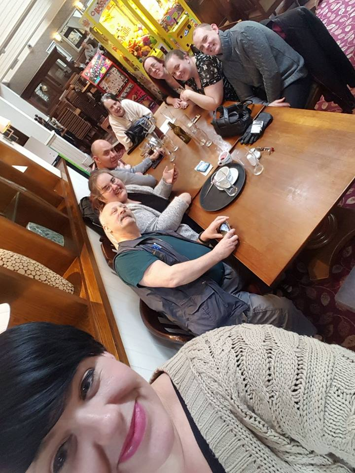 Gemma (John's wife) taking a photo of us all at the table