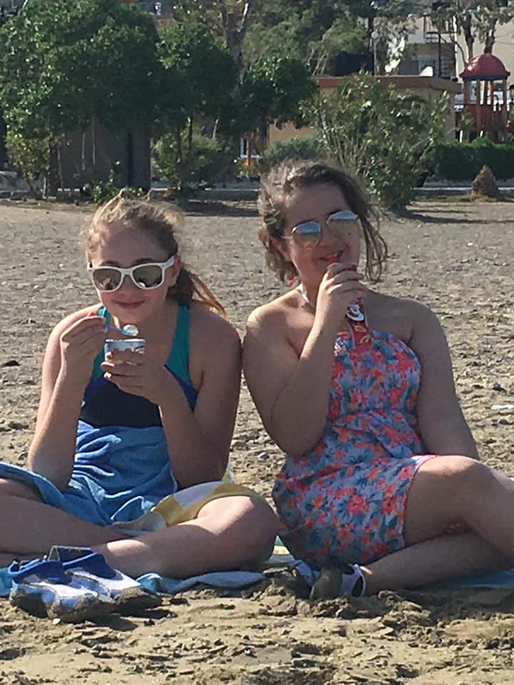 KayCee and Emma on the beach at Greece