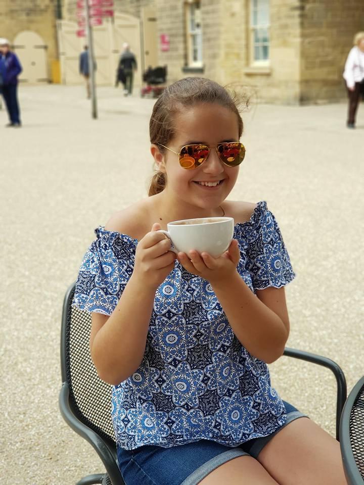 KayCee drinking hot chocolate