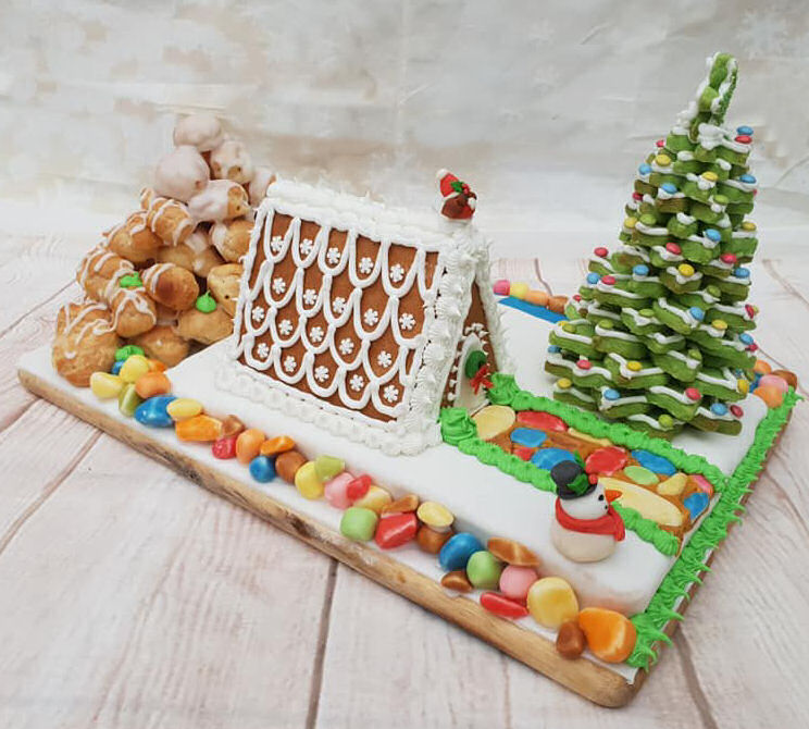 Edible landscape - gingerbread house, choux bun mountain, fudge path, shortbread 3d Christmas tree and sugar paste snowman, deer and robin