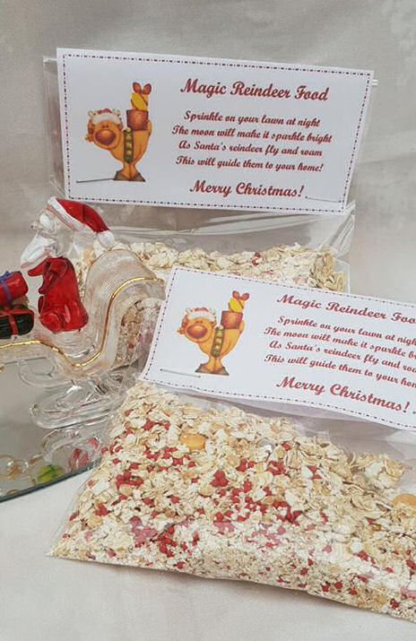 bags of magic reindeer food next to a glass Santa on a sleigh