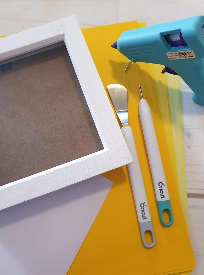 box frame, glue gun, yellow card, cricut tools
