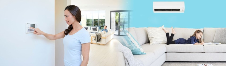 woman changing the air conditioning settings - air conditioning installations