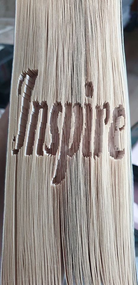 cut and fold book art spelling the word, Inspire