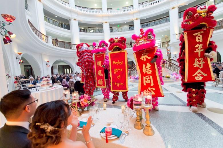 modern chinese wedding lion dancers