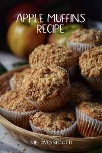 Apple muffins piled high in a wicker basket.