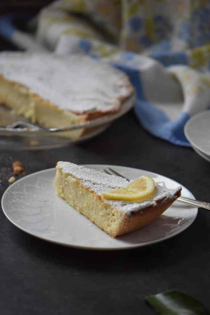 A piece of Italian Easter ricotta pie on a white plate.