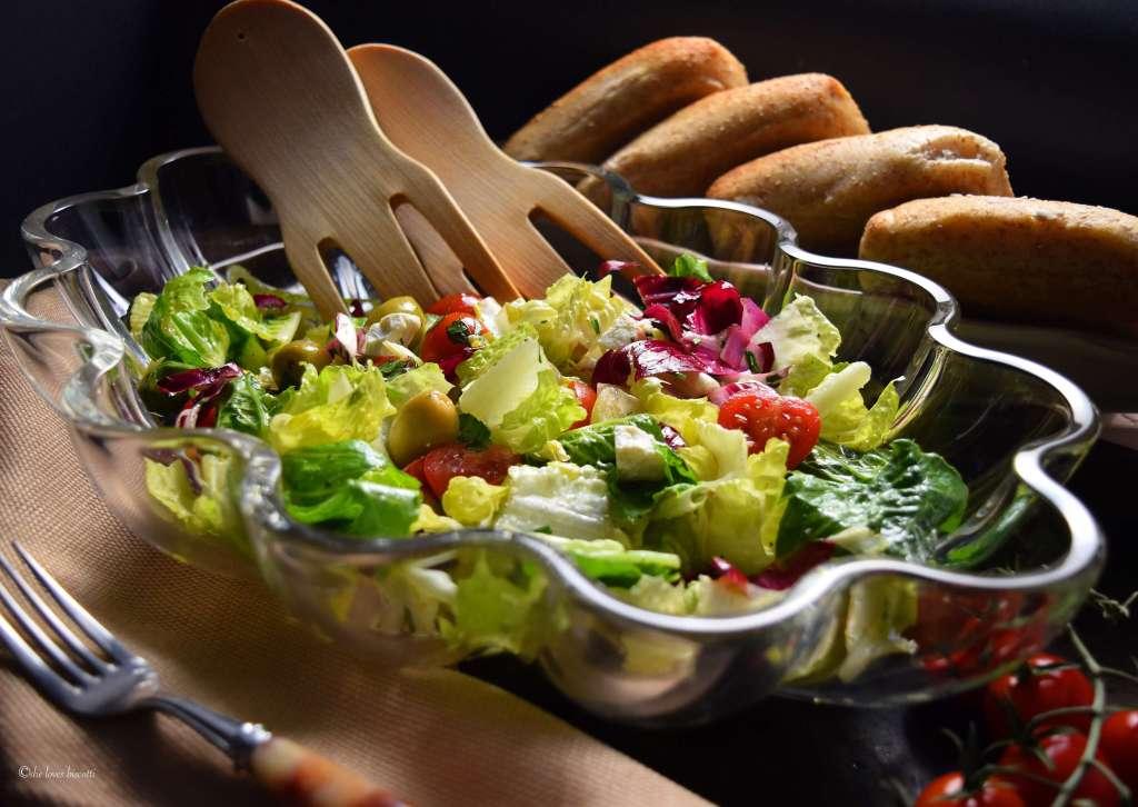 A large bowl of a colorful Italian Salad.