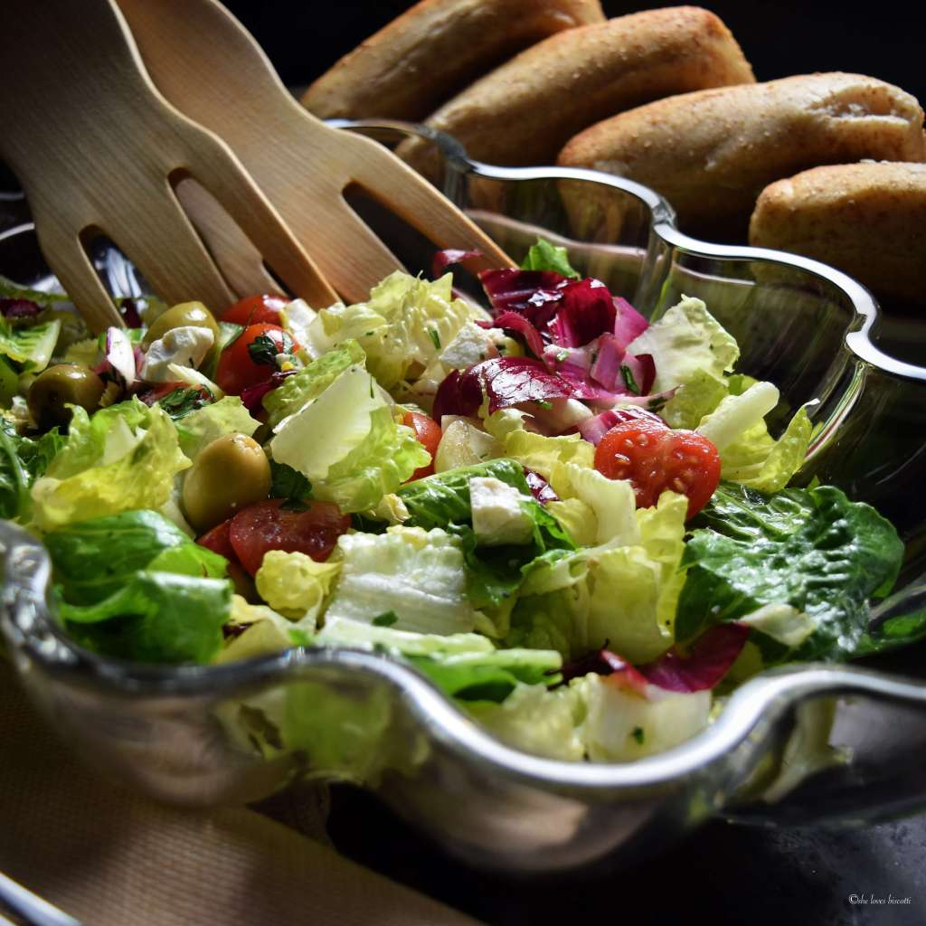 Different varieties of salads in a bowl make this Italian Salad Recipe look very appetizing.