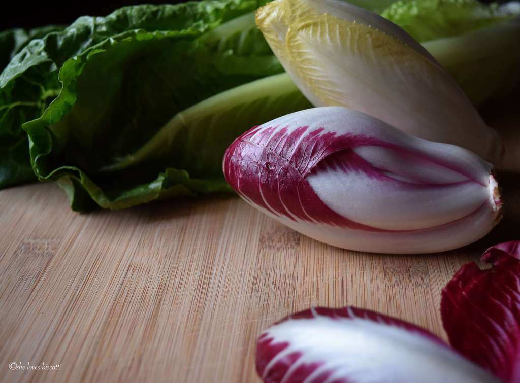A small head of endive salad ready to be chopped up.