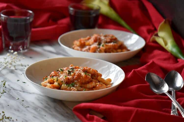 Two servings of Roasted Red Pepper sauce with pasta.