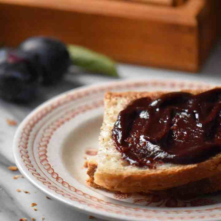 A close up shot of the fruit butter spread on a slice of whole wheat bread.