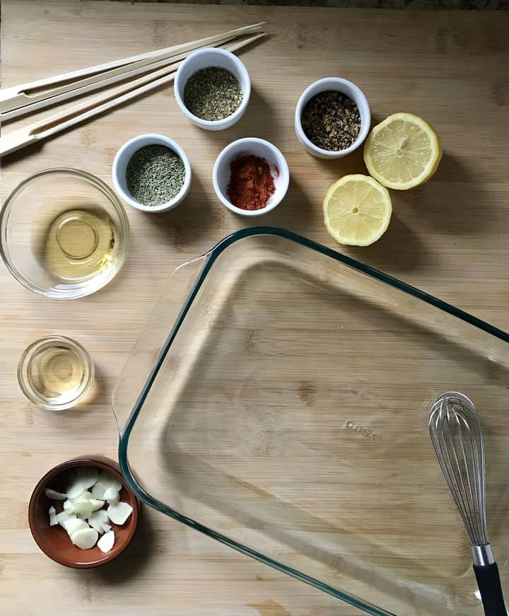 The ingredients to make the marinade for this Italian appetizer are in individual bowls.