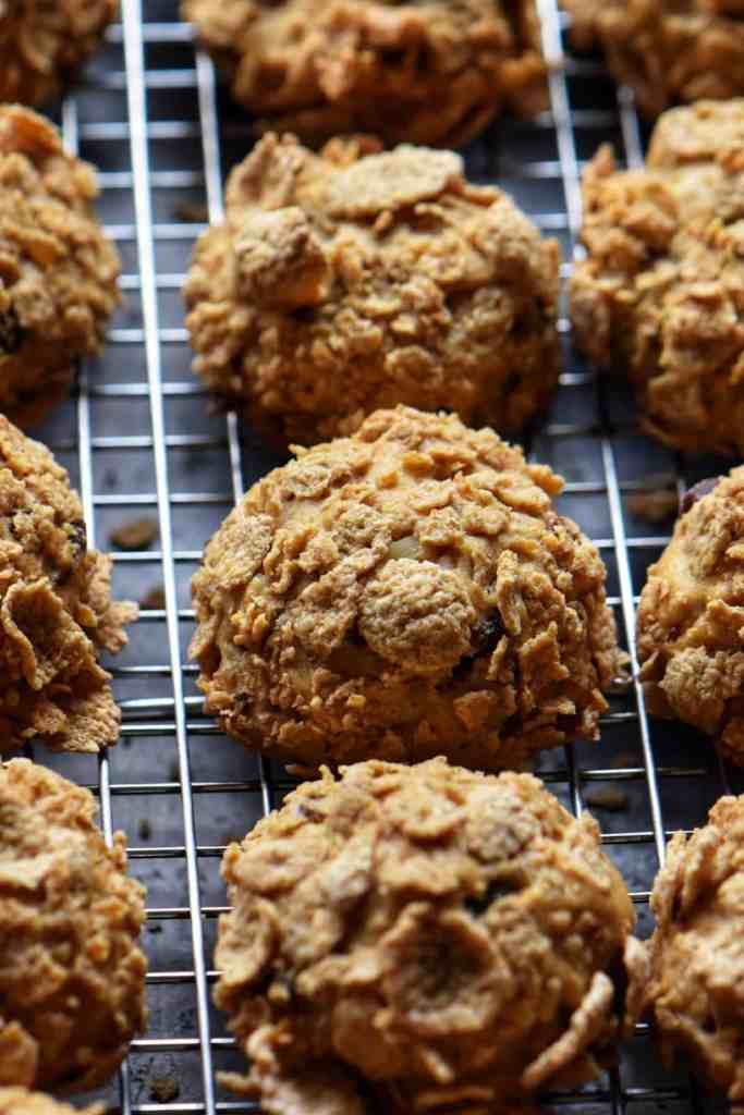 Oat date cookies cooling off on a cookie rack.