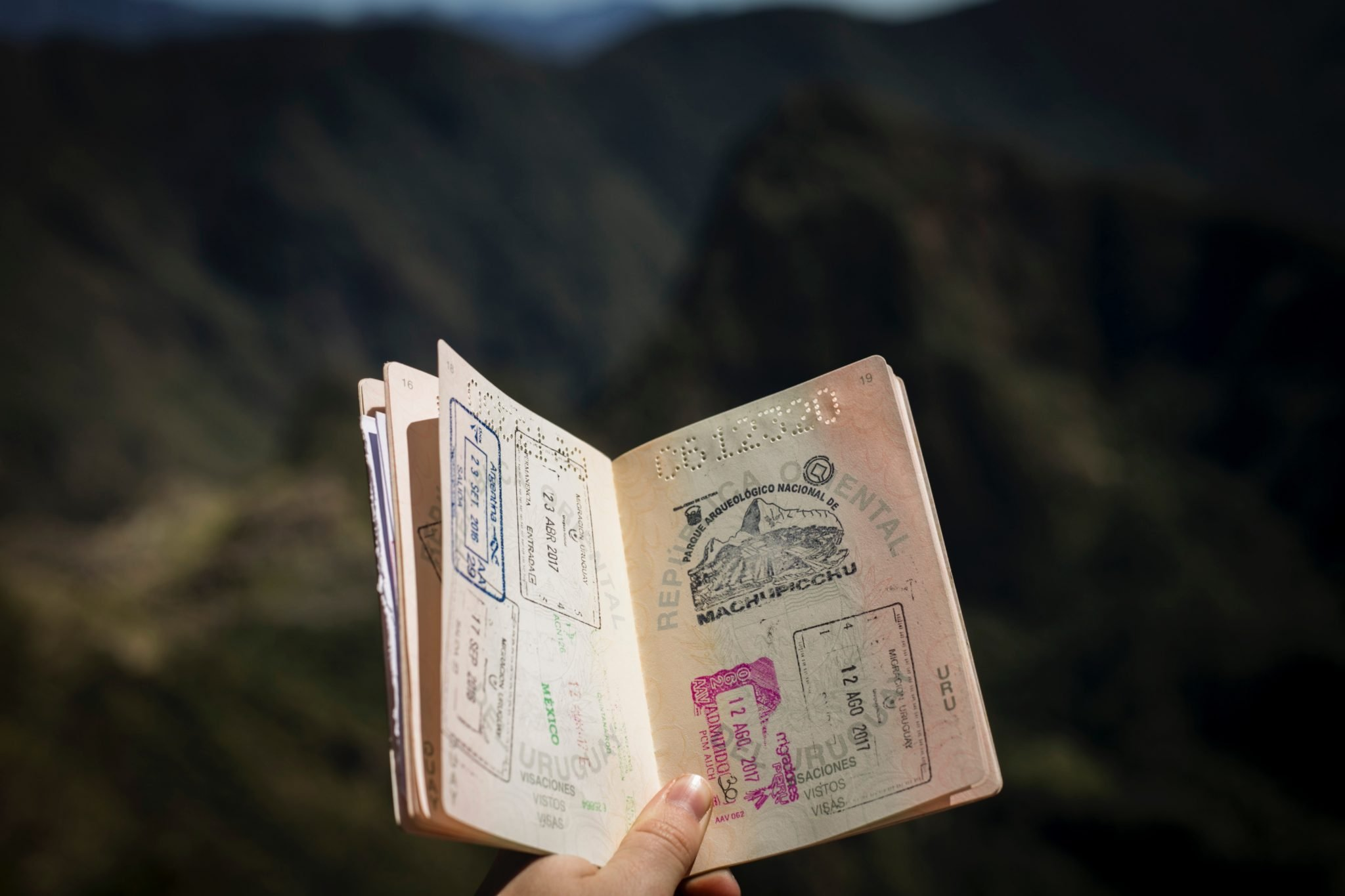 open passport travel items every backpacker must have
