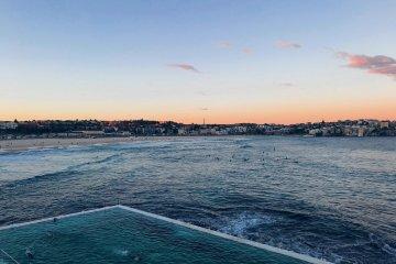 bondi-beach-icebergs-surfers-dusk