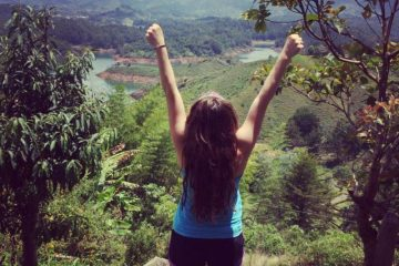 girl-arms-raised-guatape-colombia