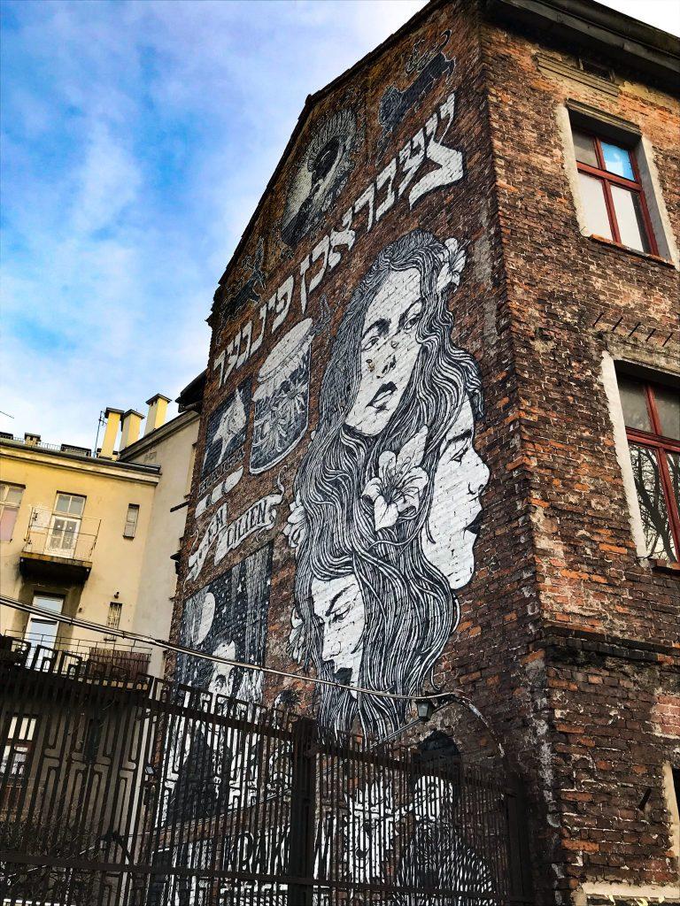 graffiti-red-brick-building-blue-sky