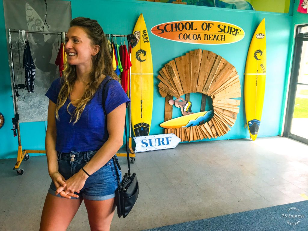 woman-standing-in-surf-shop-turquoise-wall