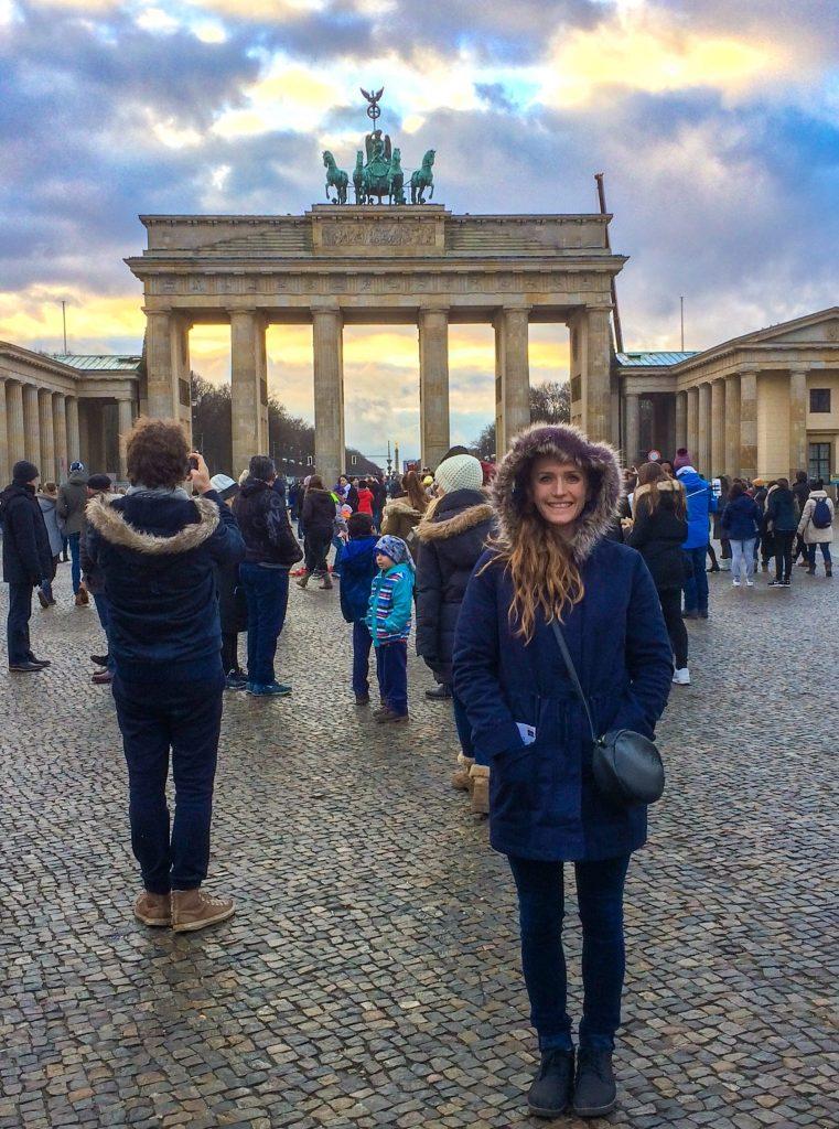 woman standing Brandenburg Gate in Berlin, Germany