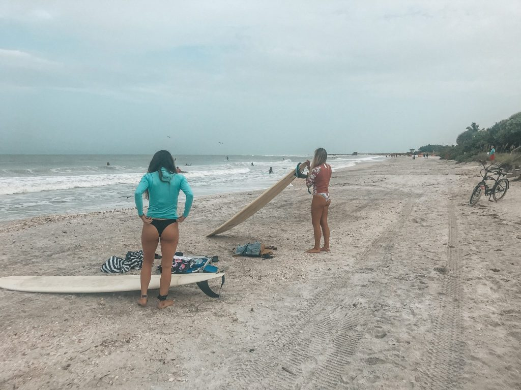 two women with surfboards lido beach sarasota florida