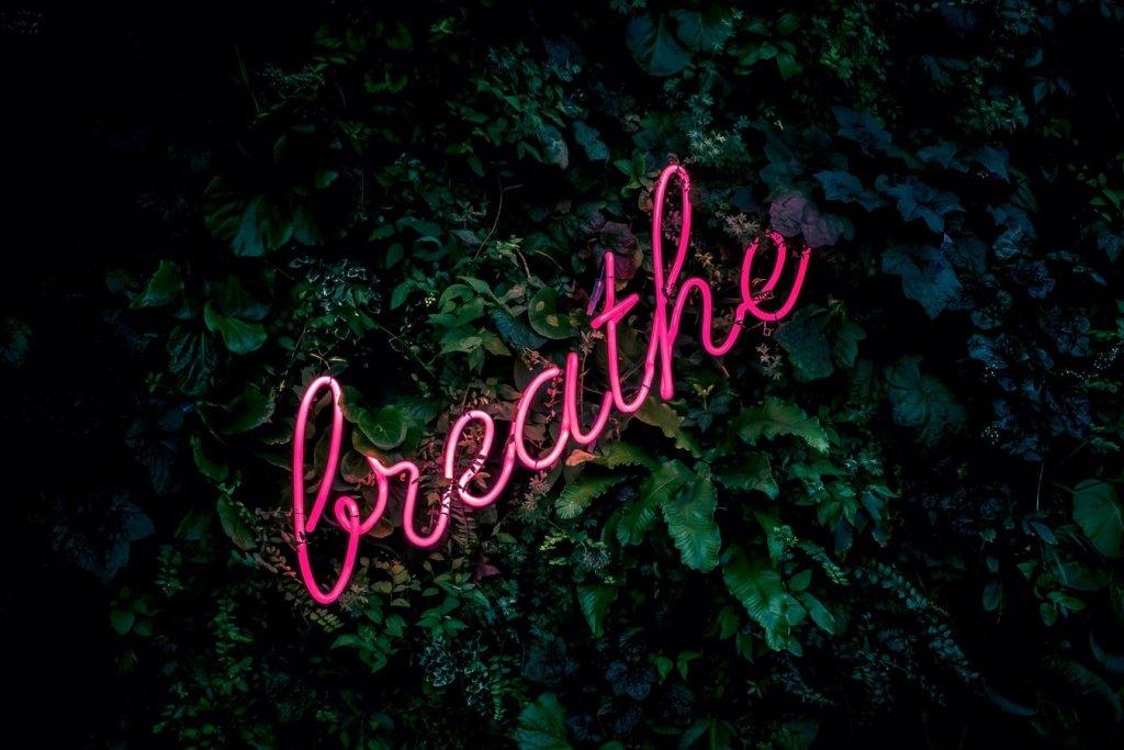 """word """"breathe"""" written in lights"""