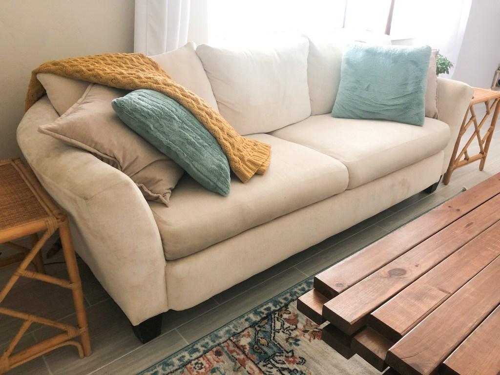 white sofa with turquoise pillows