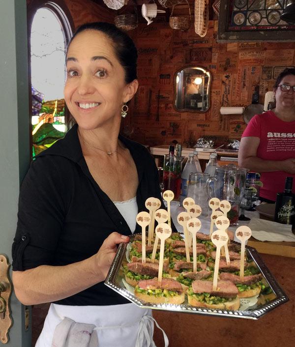 Valentina holding Asparagus Lamb Crostini