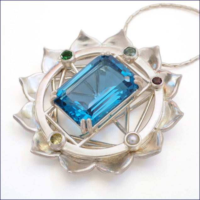 Yantra pendant with London topaz and assorted gems set in sterling silver.