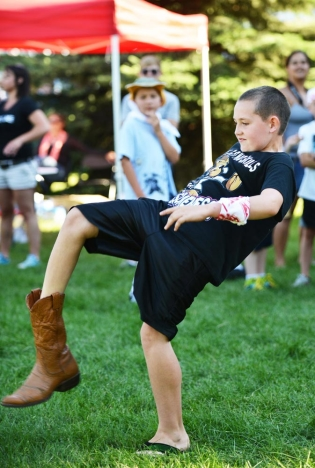 Nine-year-old Adrien Kula competes in the annual Sheridan-Wyo-Rodeo Boot Kick-off Tuesday afternoon at Kendrick Park.