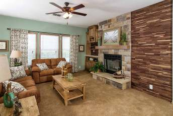 Charlevoix Living Room with Full Stone Fireplace