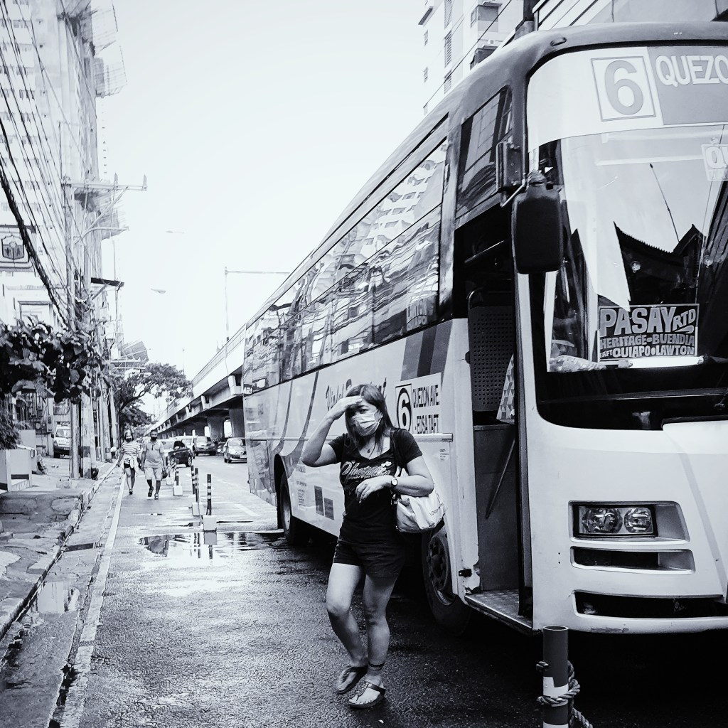 Street Photography in Manila, Philippines - Woman Alighting a Bus