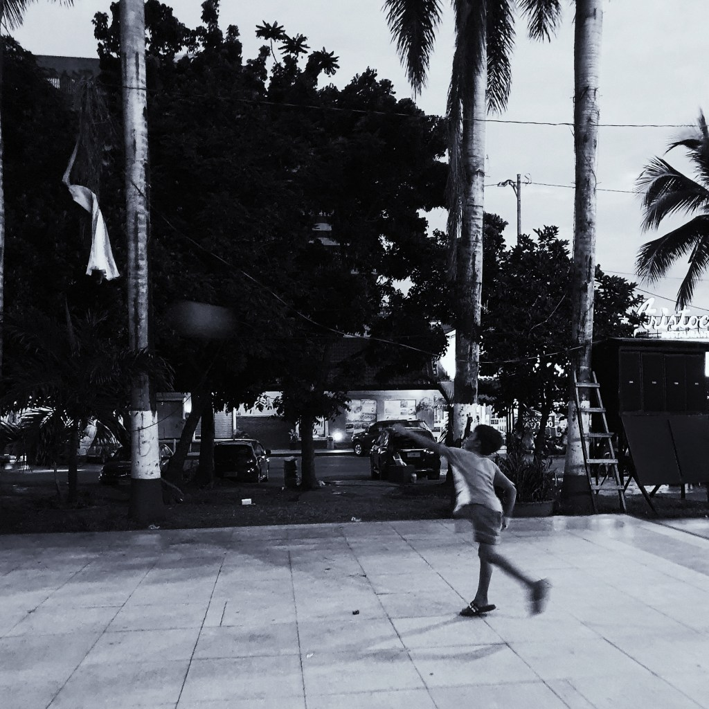 Street Photography in Manila, Philippines - Boy Throwing a Ball